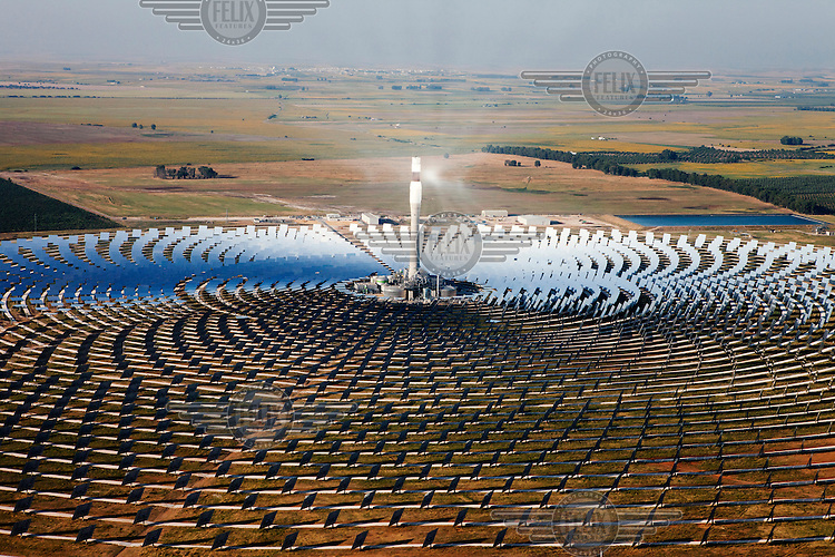 A 150 metre power tower sitting in a solar field of 2,650 heliostats at the Gemasolar Thermosolar Plant. It produces 19.9 megawatts of electricity using power tower technology.