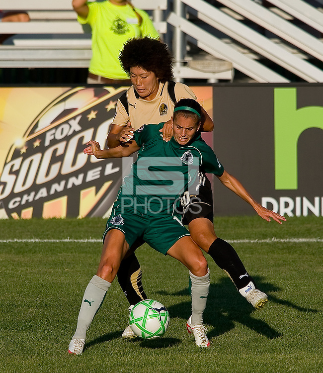 Saint Louis Athletica forward Angie Woznuk (11) and FC Gold Pride forward Eriko Arakawa (30) during a WPS match at Anheuser-Busch Soccer Park, in St. Louis, MO, July 26, 2009.  The match ended in a 1-1 tie.