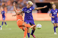 Houston, TX - Friday May 20, 2016: Andressa (17) of the Houston Dash attempts to clear the ball from Lianne Sanderson (10) of the Orlando Pride. The Orlando Pride defeated the Houston Dash 1-0 during a regular season National Women's Soccer League (NWSL) match at BBVA Compass Stadium.