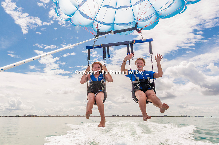 Zoe Fornberg, 16, and her sister Johanna, 18, take a parasail ride over the Gulf of Mexico from Bonita Jetski & Parasail on Bonita Beach, Florida, July 16, 2012. Photo by Debi Pittman Wilkey.