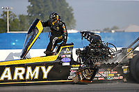 Sep 3, 2017; Clermont, IN, USA; NHRA top fuel driver Tony Schumacher climbs from his dragster after suffering an engine explosion during qualifying for the US Nationals at Lucas Oil Raceway. Mandatory Credit: Mark J. Rebilas-USA TODAY Sports