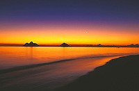 Sunrise on Lanikai beach, with the Moku Lua isands on still morning, windward Oahu