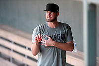 Atlanta Braves pitcher Chad Sobotka, drafted out of USC Upstate, warms up in the dugout before throwing live batting practice to other pro and amateur players from the region on Friday, June 5, 2020, at Fluor Field at the West End in Greenville, South Carolina, as team workouts remain shut down. (Tom Priddy/Four Seam Images)