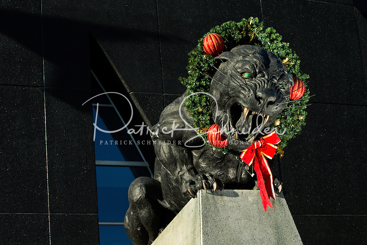 Charlotte Christmas Images - A Christmas  wreath completes the look on one of the giant panther states located outside of  Bank of America Stadium, home of the Carolina Panthers NFL football team in Uptown Charlotte, North Carolina. <br /> <br />  Charlotte Photographer - Patrick SchneiderPhoto.com