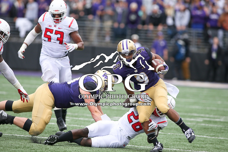 03 September 2016:  Washington's #9 Myles Gaskin breaks free from #38 Najee Clayton of Rutgers for a first down.  Washington defeated Rutgers 48-13 at the University of Washington in Seattle, WA.