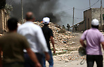 Palestinian protesters gather during clashes with Israeli troops following a demonstration against the expropriation of Palestinian land by Israel in the village of Kfar Qaddum, near Nablus, in the occupied West Bank on July 13, 2018. Photo by Shadi Jarar'ah