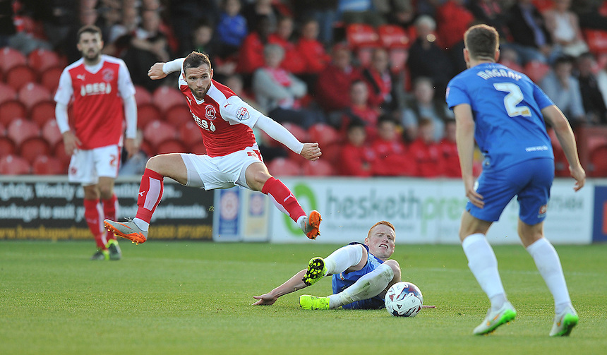 Fleetwood Town's Jimmy Ryan is tackled by Hartlepool United's Michael Woods<br /> <br /> Photographer Dave Howarth/CameraSport<br /> <br /> Football - Capital One Cup First Round - Fleetwood Town v Hartlepool United - Tuesday 11th August 2015 - Highbury Stadium - Fleetwood<br />  <br /> &copy; CameraSport - 43 Linden Ave. Countesthorpe. Leicester. England. LE8 5PG - Tel: +44 (0) 116 277 4147 - admin@camerasport.com - www.camerasport.com