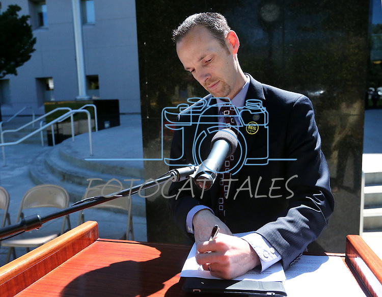Nevada Sen. Justin Jones, D-Las Vegas, prepares for a press conference in front of the Legislative Building in Carson City, Nev., on Tuesday, May 21, 2013. .Photo by Cathleen Allison