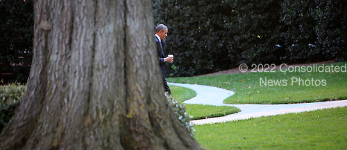 United States President Barack Obama walks from the motorcade to the Oval Office of the White House in Washington, D.C. on October 6, 2014.<br /> Credit: Dennis Brack / Pool via CNP