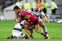PICTURE BY ALEX WHITEHEAD/SWPIX.COM - Rugby League - Super League Play-Off - Hull FC vs Huddersfield Giants - KC Stadium, Hull, England - 16/09/12 - Huddersfield's Jason Chan is tackled by Hull FC's defence.