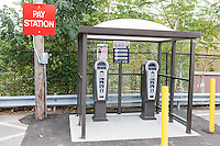 A multi-space parking pay station serving a metered lot at the Metro-North North White Plains Station in White Plains, New York.