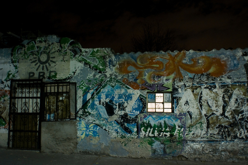 The facad of an old building near Tacubaya. Bike rides around Mexico City at night with Luis Mdahuar, Mike Smith, and Kurt Hollander (during the swine flu pandemic).  Mexico DF May 6, 2009
