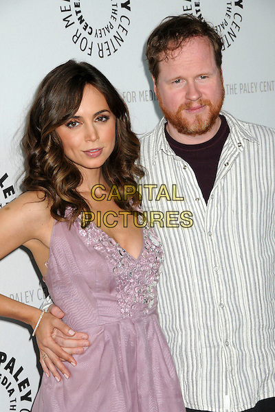 "ELIZA DUSHKU & JOSS WHEADON .The 26th Annual William S. Paley Television Festival presents ""Dollhouse"" held at Arclight Cinemas. .Hollywood, CA, USA, .15th April 2009..half length dress cleavage lilac purple pink dress striped shirt .CAP/ADM/BP.©Byron Purvis/Admedia/Capital Pictures"