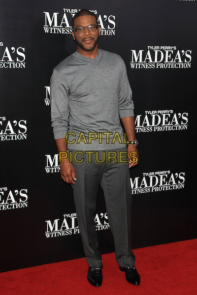 "Tyler Perry.The Premiere of ""Madea's Witness Protection"" held at AMC Loews Lincoln Square Cinemas, New York, NY., USA..June 25th, 2012.full length grey gray top trousers glasses beard facial hair .CAP/LNC/TOM.©LNC/Capital Pictures."