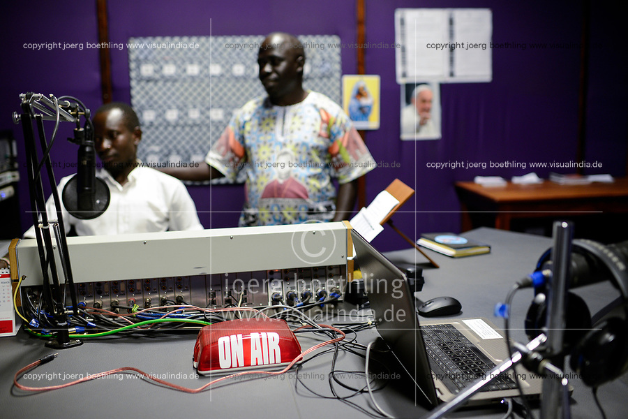 UGANDA, Arua, Radio Pacis, on air, live broadcasting studio, Station Manager Gaetano Apamaku