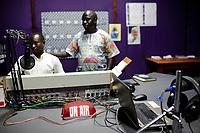 UGANDA, Arua, Radio Pacis, on air, live broadcasting studio, Station Manager Gaetano Apamaku