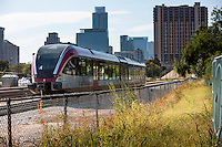 MetroRail train passes through downtown Austin headed to the Plaza Saltillo Capital Metro Rail commuter rail station East Austin.