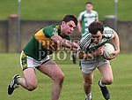 O'Raghallaigh's Eoin Moore Cooley Kickhams Conor Kenny. Photo:Colin Bell/pressphotos.ie