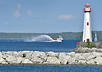 A ferry on its way to Mackinac Island passes by the Wawatam Lighthouse in St. Ignace.