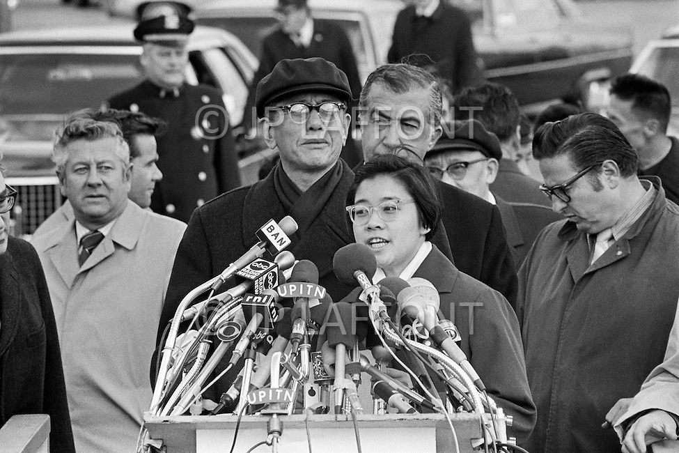11 Nov 1971 --- The UN delegation of the People's Republic of China arrive at JFK airport to take part in the United Nations General Assembly. Upon arrival Ms Wang Hai Yong (C), the niece of President Mao, addresses the press with the Vice Minister of Foreign Affairs, and head of the delegation, Chiao Kuan Hua (Center L). On October 25, 1971, the United Nations General Assembly admitted the People's Republic of China as a UN and permanent member of the Security Council, expelling the Republic of China (or nationalist Taiwan). --- Image by © JP Laffont