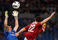 Calcio, Serie A: Roma vs Chievo Verona. Roma, stadio Olimpico, 7 maggio 2013..ChievoVerona goalkeeper Christian Puggioni grabs the ball past AS Roma forward Mattia Destro, right, during the Italian Serie A football match between AS Roma and ChievoVerona at Rome's Olympic stadium, 7 May 2013..UPDATE IMAGES PRESS/Riccardo De Luca