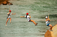 Participants take flight, zooming through the air over the US National Whitewater Center (USNWC) on the USNWC's zip-lines, part of the facilities high-adventure offerings. The popular outdoor adventure activity lets outdoor enthusiasts be secured into a harness then propelled by gravity along an inclined steel cable. Charlotte, North Carolina's US National Whitewater Center offers multiple zip line courses, which vary in height and distance traveled, as well as one of the largest outdoor climbing facilities in the world. The USNWC is a non-profit outdoor recreation facility open to the public for whitewater rafting, kayaking, canoeing, rappelling, zip lining, mountain biking, hiking, climbing and more. The center opened to the public in 2006.