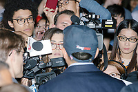 """Entrepreneur and Democratic presidential candidate Andrew Yang speaks to a media gaggle after speaking to a large crowd in Cambridge Common near Harvard Square in Cambridge, Massachusetts, on Mon., September 16, 2019. Yang's unlikely presidential bid is centered on his idea for a """"Freedom dividend,"""" which would give USD$1000 per month to every adult in the United States. After appearing in three Democratic party debates, Yang has risen in polls from longshot candidate to within the top 10."""