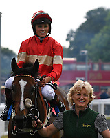 Exceeding Power ridden by George Wood is led into the winners enclosure after winning The Total Decor Ltd Handicap,  during Ladies Evening Racing at Salisbury Racecourse on 15th July 2017