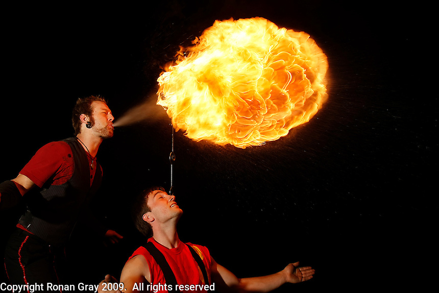 Monday, May 25 2009, San Diego, CA, USA:  Jonathan Nowaczyk (R) and Keane Carlson put on a fireshow for beach goers on the sand near Pacific Beach Drive at the start of the Memorial Day Weekend.