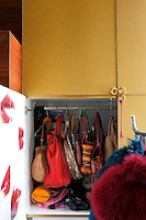 Modular cupboards conceal an endless collection of handbags, shoes and clothing