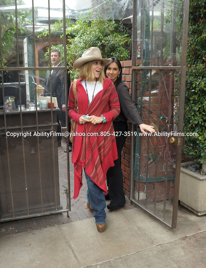 ...March 16th 2012..Brooke Mueller dressed like a cowboy or cowgirl carrying a cow fur purse & hat  wearing a red Mexican jacket poncho with her mom leaving Kathy Hiltons Birthday launch party in Los Angeles . carrying a flower plant basket ..AbilityFilms@yahoo.com.805-427-3519.www.AbilityFilms.com.