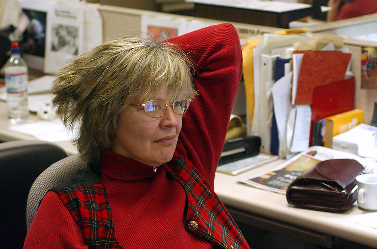 Lisa May, photographed at Newsday in Melville on Friday December 24, 2004. (Photo copyright Jim Peppler 2004).