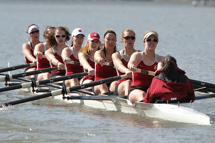 Members of the 15th ranked Washington State University women's varsity rowing crew compete against the 7th ranked University of Washington in dual action at Wawawai Landing on the Snake River near Pullman, Washington, on April 9, 2011.  The Huskies swept the regatta and regained the Apple Cup for winning the varsity eight race.