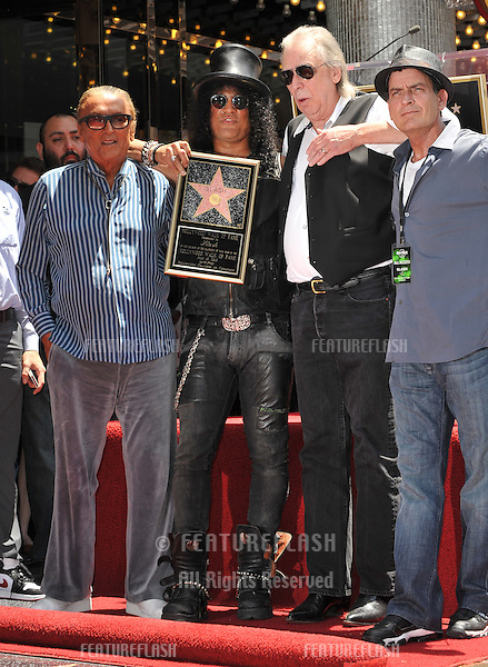 Rock guitarist Slash with Robert Evans, Jim Ladd & Charlie Sheen on Hollywood Blvd where he was honored with a star on the Hollywood Walk of Fame..July 10, 2012  Los Angeles, CA.Picture: Paul Smith / Featureflash