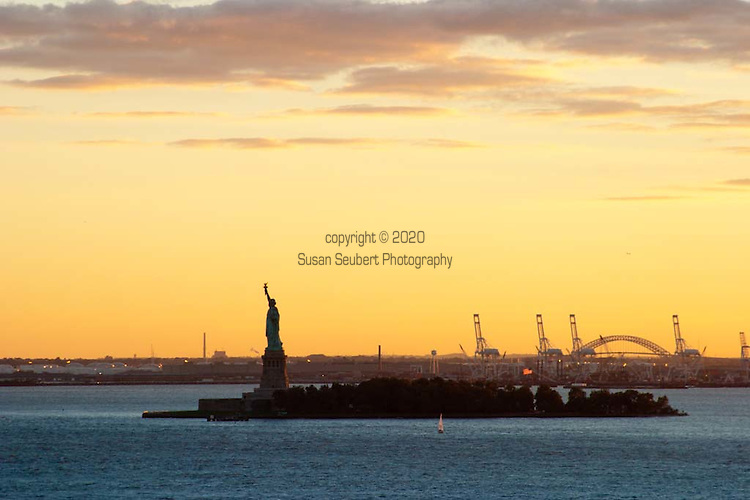 The view of the Statue of Liberty from the sky bar at the Ritz Carlton Battery Park in the Financial District of downtown Manhattan