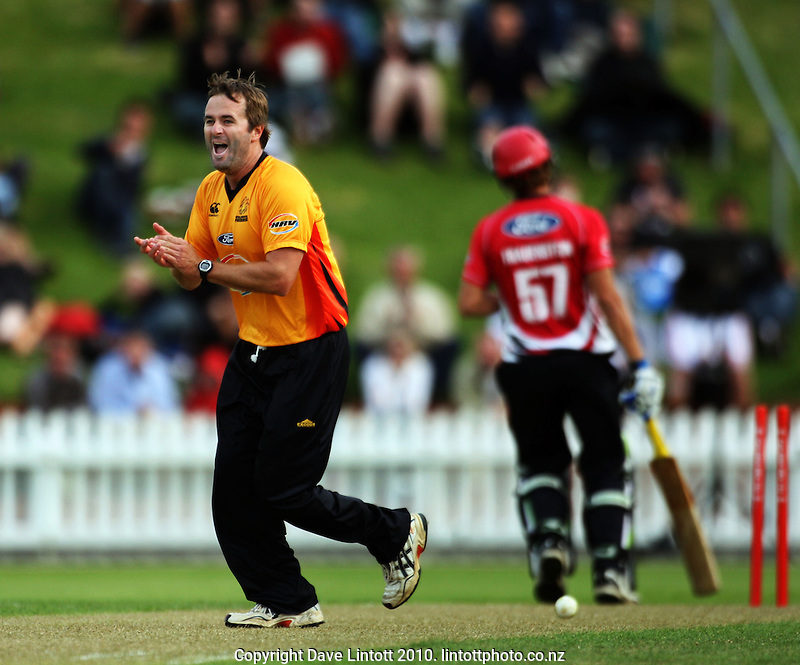Wellington bowler Paul Hitchcock congratulates Chris Nevin on running out Carl Frauenstein during the HRV Cup Twenty20 cricket match between the Wellington Firebirds and Canterbury Wizards at Allied Nationwide Finance Basin Reserve, Wellington, New Zealand on Wednesday, 6 January 2010. Photo: Dave Lintott / lintottphoto.co.nz