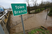 Water floods out of Town Branch Creek Thursday, March 19, 2020, and covers a section of the Razorback Greenway near South School Avenue in Fayetteville. Heavy rains caused flooding and submerged portions of the Razorback Regional Greenway Trail including portions of the Town Branch section. Check out nwaonline.com/200320Daily/ and nwadg.com/photos for a photo gallery.<br /> (NWA Democrat-Gazette/David Gottschalk)