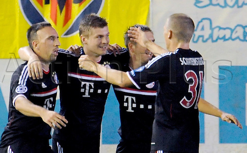 14.09.2011 Franck Ribery (l-r), scorer Toni Kroos, Philipp Lahm and Bastian Schweinsteiger of Bayern Munich celebrate their first goal during the Champions League group A soccer match between Villarreal CF and FC Bayern Munich at El Madrigal stadium in Villarreal, Spain.
