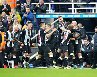30th November 2019; St James Park, Newcastle, Tyne and Wear, England; English Premier League Football, Newcastle United versus Manchester City; Jonjo Shelvey of Newcastle United is celebrates with Paul Dummett Jetro Willems Federico Fernandez Paul Dummett Miguel Almiron and Ciaran Clark of Newcastle Unitednafter he equalises in the 88th minute to make it 2-2  - Strictly Editorial Use Only. No use with unauthorized audio, video, data, fixture lists, club/league logos or 'live' services. Online in-match use limited to 120 images, no video emulation. No use in betting, games or single club/league/player publications