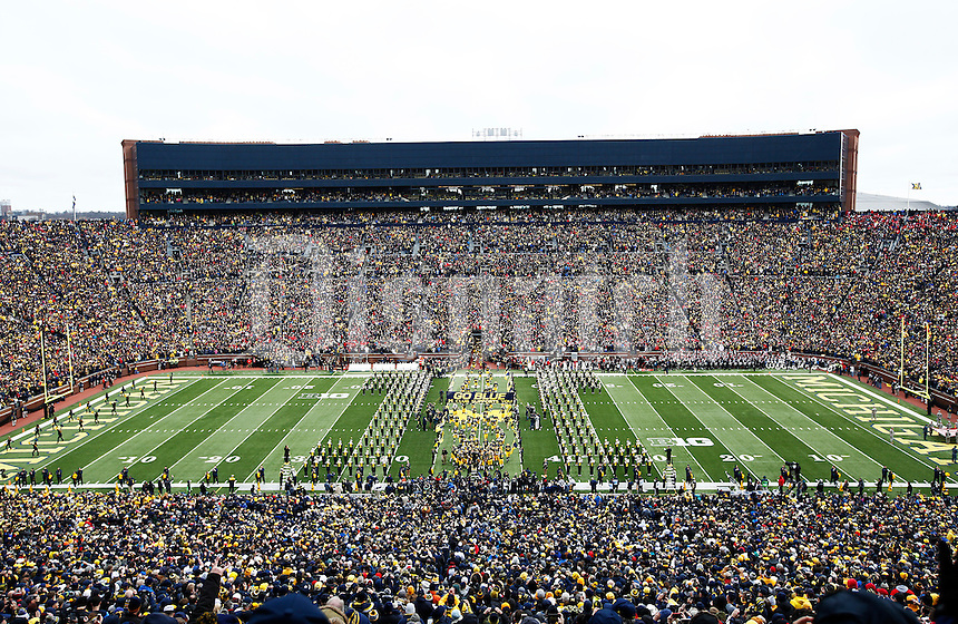 The Michigan Wolverines run on to the field before the college football game between the Michigan Wolverines and the Ohio State Buckeyes at Michigan Stadium in Ann Arbor, Saturday afternoon, November 28, 2015. The Ohio State Buckeyes defeated the Michigan Wolverines 42 - 13. (The Columbus Dispatch / Eamon Queeney)