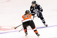Yale's Madi Murray (22) and RIT's Katie Hubert (22) battle for the puck in the third period. RIT defeated Yale 3-0 at Blue Cross Arena in Rochester, New York on October 20, 2012