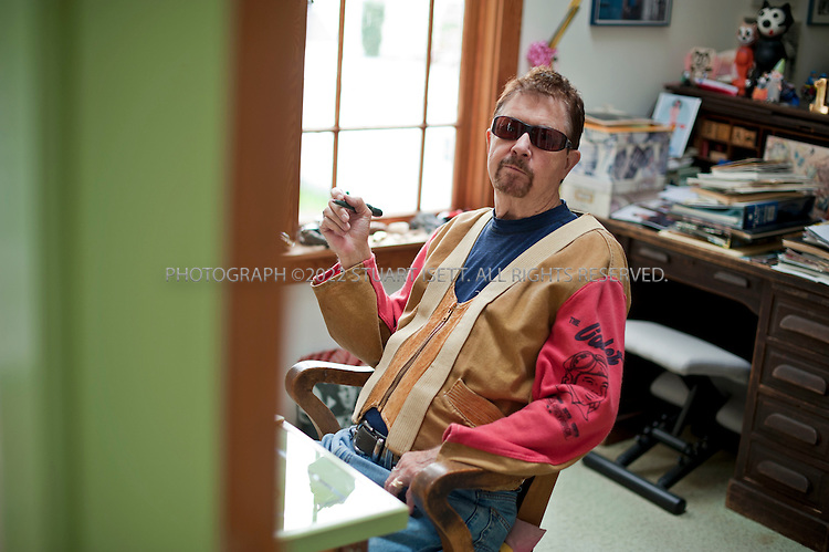 9/9/2010--La Conner WA, USA..American author Tom Robbins, born July 22, 1936, at his writing desk in his home in La Conner, Washington, north of Seattle. He is probably best known for his novel 'Even Cowgirls Get the Blues' (1976), which was made into a movie in 1993 directed by Gus Van Sant and starring Uma Thurman and Keanu Reeves....©2010 Stuart Isett. All rights reserved