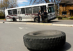 The rear tire of a UM bus sits in the Park-N-Ride parking lot after it was torn off when making a right turn down South Avenue on Friday afternoon.  The tire struck a parked car causing damage to the driver's-side door.