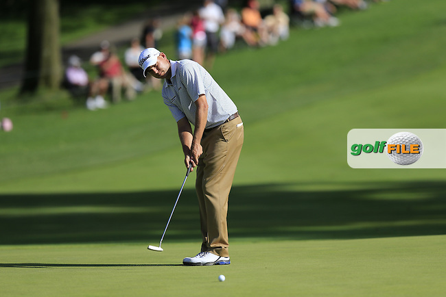 Bill Haas (USA) putts on the 18th green during Saturday's Round 3 of the 2013 Bridgestone Invitational WGC tournament held at the Firestone Country Club, Akron, Ohio. 3rd August 2013.<br /> Picture: Eoin Clarke www.golffile.ie