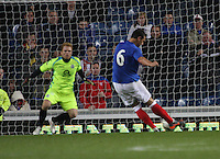 Lee McCulloch scores from the penalty spot against Lee Robinson to take the lead in the Rangers v Queen of the South Quarter Final match in the Ramsdens Cup played at Ibrox Stadium, Glasgow on 18.9.12.