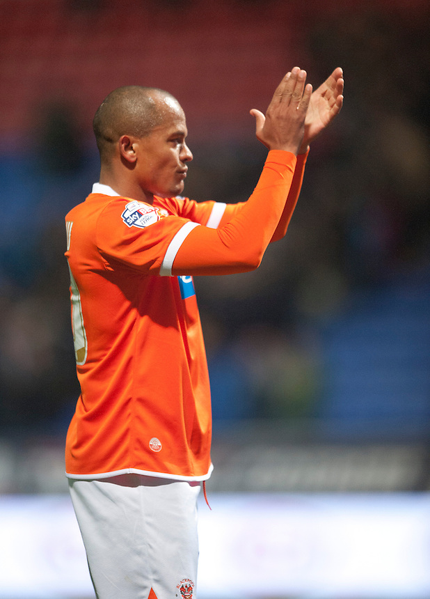 Blackpool's Robert Earnshaw applauds the traveling fans at the final whistle<br /> <br /> Photo by Stephen White/CameraSport<br /> <br /> Football - The Football League Sky Bet Championship - Bolton Wanderers v Blackpool - Tuesday 25th March 2014 - The Reebok Stadium - Bolton<br /> <br /> &copy; CameraSport - 43 Linden Ave. Countesthorpe. Leicester. England. LE8 5PG - Tel: +44 (0) 116 277 4147 - admin@camerasport.com - www.camerasport.com