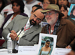Mexican poet and activist Javier Sicilia (R) smiles while Emilio Alvarez Icaza whispers at him during the dialogue with members of the National Movement for Peace with Justice and Dignity (MPJD) in the Alcazar del Castillo de Chapultepec venue in Mexico City, May 28. 2012. Sicilia and the mothers of disappeared people demanded peace to Mexico and the punishment of the authorities linked to the organized crime in Mexico. Photo by Heriberto Rodriguez