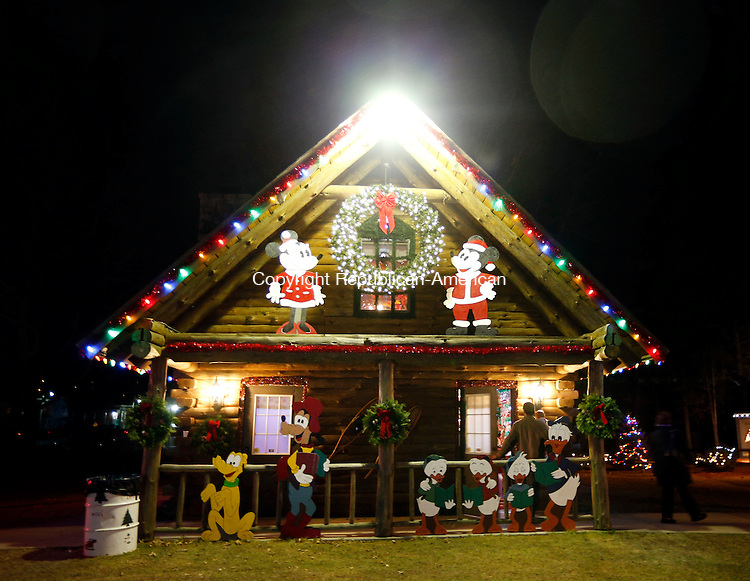 Torrington, CT- 15 December 2015-121515CM04-  Visitors leave the toy shop inside  Carl Bozenski's  Christmas Village in Torrington on Tuesday.  The village will be open through December 23 from 1:00- 8:30 PM.      Christopher Massa Republican-American