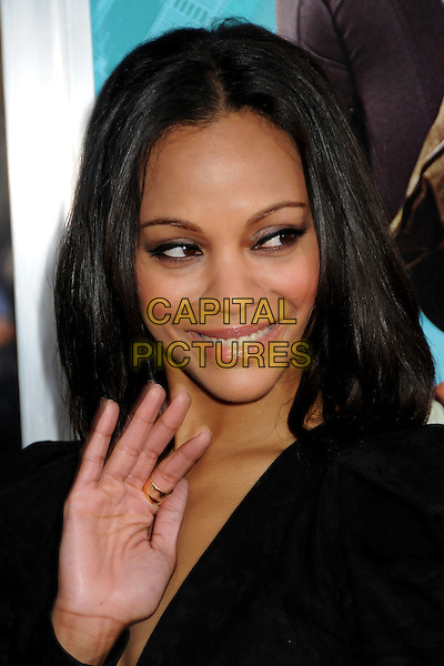 "ZOE SALDANA.""The Losers"" Los Angeles Premiere held at Grauman's Chinese Theatre, Hollywood, California, USA, .20th April 2010..portrait headshot black smiling make-up hand waving  .CAP/ADM/BP.©Byron Purvis/AdMedia/Capital Pictures."