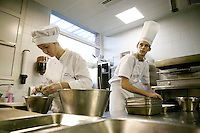 Students prepare ingredients at the start of a class at the Ecole Superieure de Cuisine Francaise Gregoire Ferrandi cooking school in Paris, France, 18 December 2007.